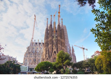 BARCELONA - DECEMBER 12: Overview with Sagrada Familia basilica with touristd on December 12, 2018 in Barcelona, Spain.