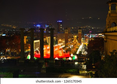 BARCELONA - DECEMBER 13: Magic Fountain of Montjuic with people at night on December 13, 2018 in Barcelona, Spain.
