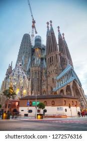 BARCELONA - DECEMBER 13: Overview with Sagrada Familia basilica at sunrise on December 13, 2018 in Barcelona, Spain.