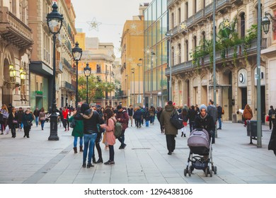 BARCELONA - DECEMBER 14: Crowded with tourists La Rambla on December 14, 2018 in Barcelona, Spain.