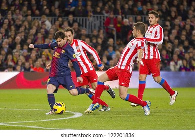 BARCELONA - DECEMBER 16: Lionel Messi (L) in action at the Spanish League match between FC Barcelona and Atletico de  Madrid, final score 4 - 1, on December 16, 2012, in Camp Nou, Barcelona, Spain.