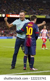 BARCELONA - DECEMBER 16: Spontaneous supporter and Lionel Messi at the Spanish League match between FC Barcelona and Atletico de  Madrid, final score 4 - 1, on December 16, 2012, in Barcelona, Spain.