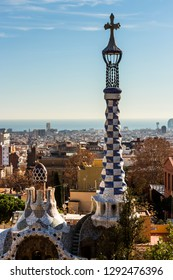 Barcelona - December 2018: Conical spire and cross at Park Guell, designed by Antoni Gaud, built from 1900 to 1914