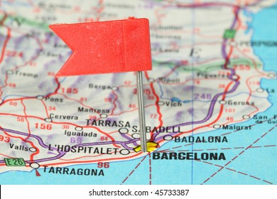 Barcelona - famous city in Spain. Red flag pin on an old map showing travel destination.