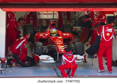 BARCELONA - FEBRUARY 18: Fernando Alonso (Ferrari) in the pits during Formula One Teams Test Days at Catalunya circuit, on February 18, 2011 in Barcelona (Spain).