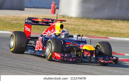 BARCELONA - FEBRUARY 21: Sebastian Vettel of Red Bull F1 team racing at Formula One Teams Test Days at Catalunya circuit on February 21, 2012 in Barcelona, Spain.