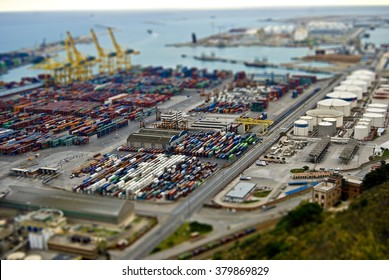 Barcelona harbor with cargo and factories. Tilt Shift Effect