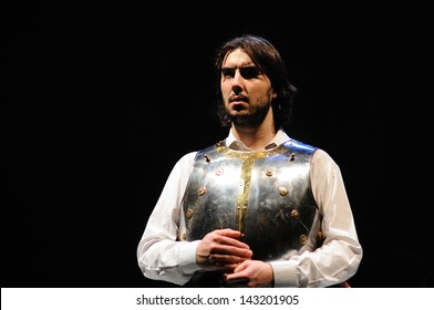 BARCELONA - JAN 13: An actor, with an armor, of the Barcelona Theater Institute, poses in the comedy Shakespeare For Executives on January 13, 2013 in Barcelona, Spain.