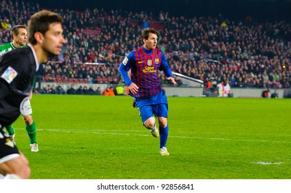 BARCELONA – JAN. 15: Leo Messi (R) in action during the match between FC Barcelona vs Real Betis, 4 - 2, in Camp Nou stadium on January 15, 2012, Barcelona, Spain.