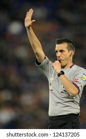 BARCELONA - JAN, 2: International referee Javier Estrada Fernandez during the friendly match between Catalonia and Nigeria at Estadi Cornella on January 2, 2013 in Barcelona, Spain