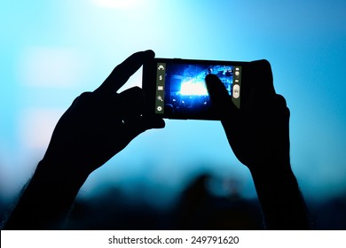BARCELONA - JAN 29: A man with his smartphone takes a picture  in a concert at Razzmatazz venue on January 29, 2015 in Barcelona, Spain.