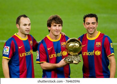 BARCELONA - JANUARY 12: Andres Iniesta (L), Leo Messi (middle) and Xavi Hernandez (R) offering the FIFA World Player Award to the FC Barcelona supporters, on January 12, 2011 in Barcelona (Spain).