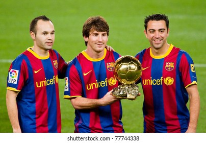 BARCELONA - JANUARY 12: Andres Iniesta, Leo Messi and Xavi Hernandez present the World Player Gold Ball to the supporters of FC Barcelona on January 12, 2011 in Nou Camp stadium in Barcelona, Spain.