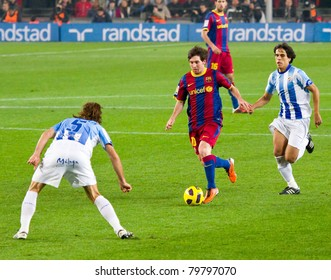 BARCELONA - JANUARY 16: Leo Messi (10) in action during Spanish League match between FC Barcelona and Malaga, 4 - 1, in Camp Nou Stadium. January 16, 2011 in Barcelona (Spain).