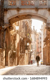 BARCELONA - JANUARY 25, 2009: The narrow street of Carrer del Bisbe in the old town of the Barri Gotic