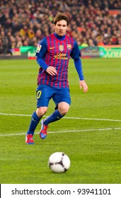 BARCELONA - JANUARY 25: Lionel Messi in action during the Spanish Cup match between FC Barcelona and Real Madrid, final score 2 - 2, on January 25, 2012, in Barcelona, Spain.
