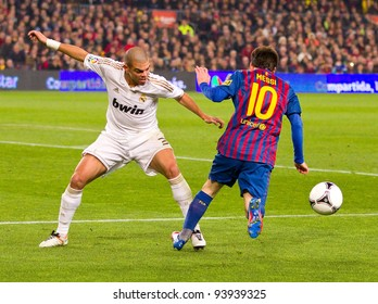 BARCELONA - JANUARY 25: Pepe Laveran (L) and Leo Messi in action during the Spanish Cup match between FC Barcelona and Real Madrid, final score 2 - 2, on January 25, 2012, in Barcelona, Spain.
