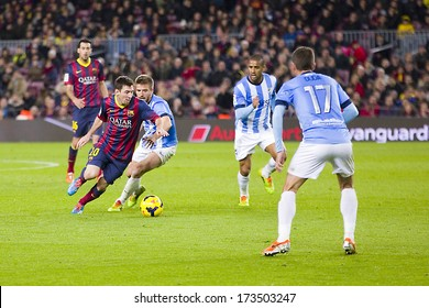 BARCELONA - JANUARY 26: Lionel Messi (L) of FCB in action at Spanish league match between FC Barcelona and Malaga CF, final score 3-0, on January 26, 2014, in Barcelona, Spain.