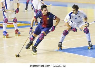 BARCELONA - JANUARY 26: Marc Torra (L) and Oriol Vives at Spanish OK League match between FC Barcelona and Igualada HC, final score 4-5, on January 26, 2013, in Palau Blaugrana, Barcelona, Spain.