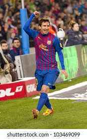 BARCELONA - JANUARY 4: Leo Messi celebrating a goal during the Spanish Cup match between FC Barcelona and Osasuna, final score 4 - 0, on January 4, 2012 in Camp Nou stadium, Barcelona, Spain.