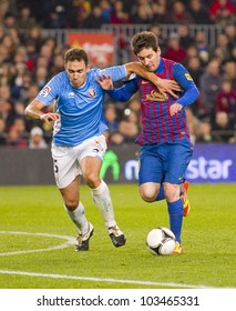 BARCELONA - JANUARY 4: Lionel Messi (R) of Barcelona in action during the Spanish Cup match between FC Barcelona and Osasuna, final score 4-0, on January 4, 2012 in Camp Nou stadium, Barcelona, Spain.