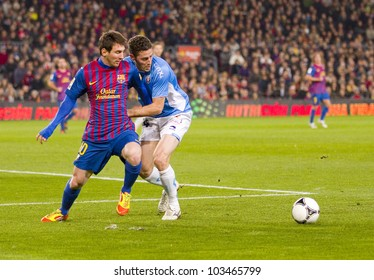 BARCELONA - JANUARY 4: Lionel Messi (L) of FCB in action during the Spanish Cup match between FC Barcelona and Osasuna, final score 4 - 0, on January 4, 2012 in Camp Nou stadium, Barcelona, Spain.