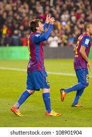 BARCELONA - JANUARY 4: Lionel Messi celebrating a goal during the Spanish Cup match between FC Barcelona and Osasuna, final score 4 - 0, on January 4, 2012 in Camp Nou stadium, Barcelona, Spain.