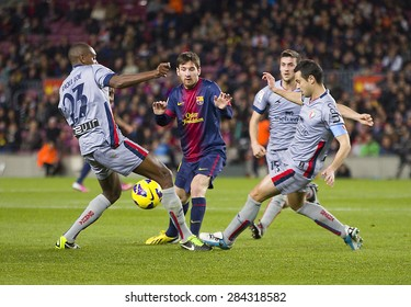 BARCELONA - JANUARY 4: Lionel Messi (10) of FCB in action at the Spanish League match between FC Barcelona and Osasuna, final score 5 - 1, on January 27, 2013, in Barcelona, Spain.