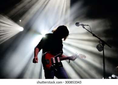 BARCELONA - JUL 3: Silhouette of the guitarist of The War on Drugs (band), in concert at Vida Festival on July 3, 2015 in Barcelona, Spain.