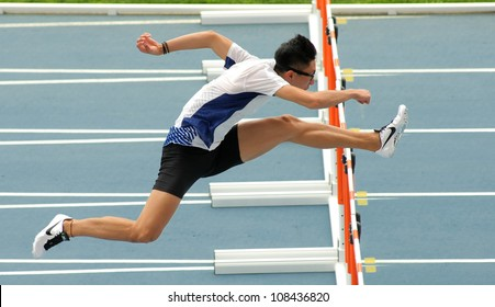 BARCELONA - JULY, 10: Ching Yeung Mui of Hong Kong warming up before 110 meters hurdles of the 20th World Junior Athletics Championships at the Olympic Stadium on July 10, 2012 in Barcelona, Spain