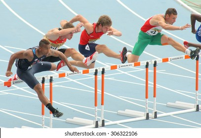 BARCELONA - JULY, 10: Competitors of 110 meters hurdles during the 20th World Junior Athletics Championships at the Olympic Stadium on July 10, 2012 in Barcelona, Spain