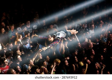 BARCELONA - JUN 1: A woman from the crowd doing crowdsurfing at Primavera Sound 2015 Festival on June 1, 2015 in Barcelona, Spain.