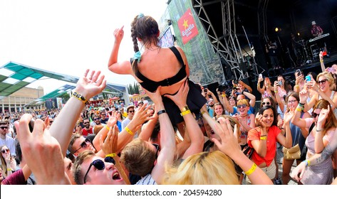 BARCELONA - JUN 12: MO (band) sings above the crowd (crowd surfing)  at Sonar Festival on June 12, 2014 in Barcelona, Spain.