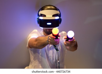 BARCELONA - JUN 16: A man tries the Playstation VR (Virtual Reality) glasses and the PlayStation Move motion controllers at Sonar Festival on June 16, 2016 in Barcelona, Spain.