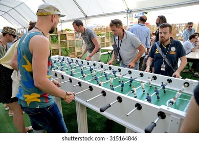 BARCELONA - JUN 19: People play in an extra large foosball (also know as table soccer and table football)  at Sonar Festival on June 19, 2015 in Barcelona, Spain.