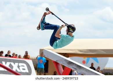 BARCELONA - JUN 28: A professional rider at the Scooter Pak competition on the Central Park at LKXA Extreme Sports Barcelona Games on June 28, 2014 in Barcelona, Spain.
