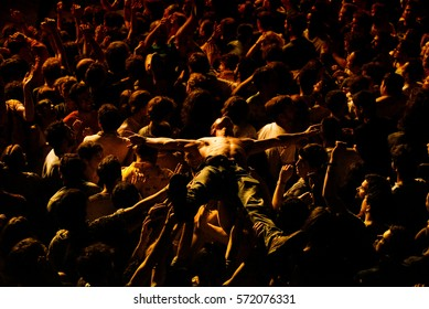 BARCELONA - JUN 5: A fan does crowd surfing with the crowd in a concert at Primavera Sound 2016 Festival on June 5, 2016 in Barcelona, Spain.