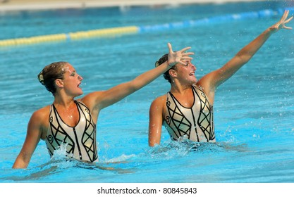 BARCELONA - JUNE 18: Argentinian synchro swimmers Etel(L) and Sofia(R) Sanchez in a Duet exercise during the Espana Sincro meeting in Barcelona Picornell Swimpool, June 18, 2011 in Barcelona, Spain