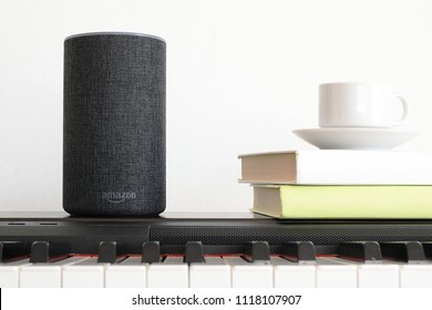 BARCELONA - JUNE 2018: Amazon Echo Smart Home Alexa Voice Service on a piano in a living room on June 20, 2018 in Barcelona.