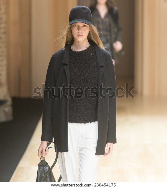 BARCELONA - JUNE 30: a model walks on the Mango catwalk during the 080 Barcelona Fashion runway Spring/Summer 2015 on June 30, 2014 in Barcelona, Spain.