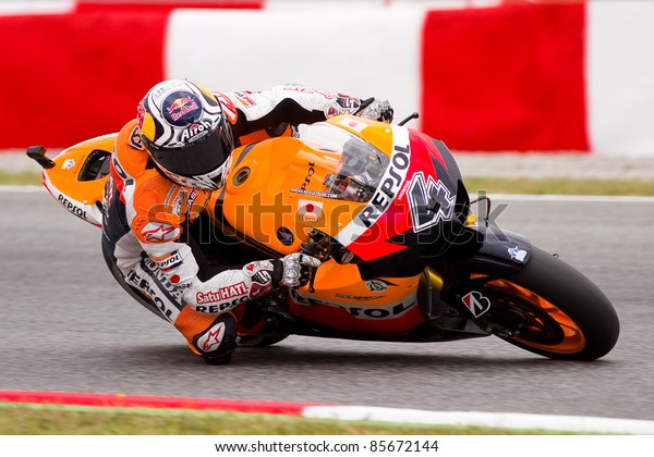 BARCELONA - JUNE 4: Andrea Dovizioso of Repsol Honda team racing at Qualifying Session of MotoGP Grand Prix of Catalunya, on June 4, 2011 in Barcelona, Spain.