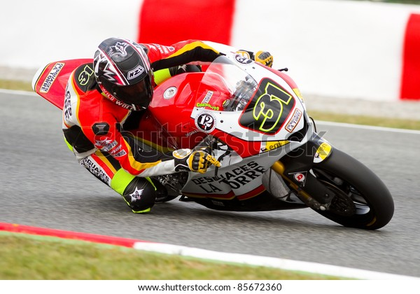 BARCELONA - JUNE 4: Carmelo Morales racing at Qualifying Session of Moto2 Grand Prix of Catalunya, on June 4, 2011 in Barcelona, Spain.