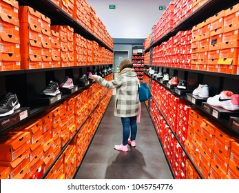 BARCELONA - MAR 13: A woman shopping shoes at the La Roca Village Nike Store on March 13, 2018 in Barcelona, Spain.