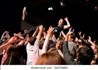 BARCELONA - MAR 18: Crowd cheering in a concert at Bikini stage on March 18, 2015 in Barcelona, Spain.