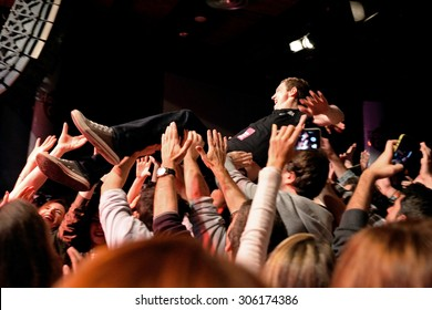 BARCELONA - MAR 18: The frontman of The Subways (rock band) performs with the crowd at Bikini stage on March 18, 2015 in Barcelona, Spain.
