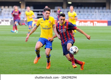 BARCELONA - MAR 18: Munir El Haddadi Mohamed (right) and Bellerin (left) fights for a ball in the match between F.C. Barcelona and Arsenal F.C. on March 18, 2014 in Barcelona, Spain.