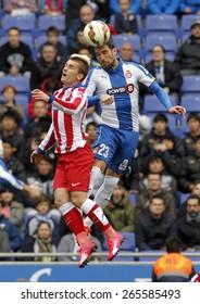 BARCELONA - MARCH, 14: Antoine Griezmann of Atletico Madrid Anaitz Arbilla of Espanyol headbutt during a Spanish League match at the Estadi Cornella on March 14, 2015 in Barcelona, Spain