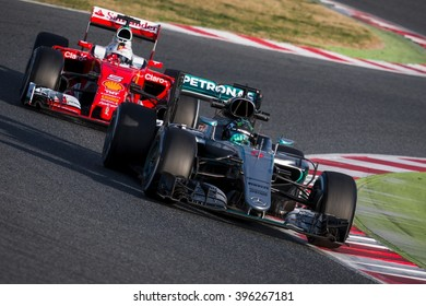 BARCELONA - MARCH 2: Nico Rosberg of Mercedes AMG F1 Team leads Sebastian Vettel of Ferrari F1 Team at Formula One Test Days at Catalunya circuit on March 2, 2016 in Barcelona, Spain.