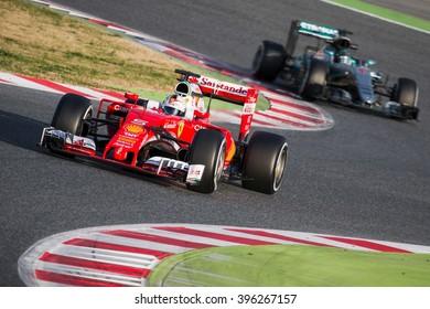 BARCELONA - MARCH 2: Sebastian Vettel of Ferrari F1 Team leads Nico Rosberg of Mercedes AMG F1 Team at Formula One Test Days at Catalunya circuit on March 2, 2016 in Barcelona, Spain.