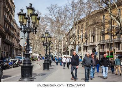 BARCELONA - MARCH, 2018: La Rambla pedestrian street in Barcelona Spain